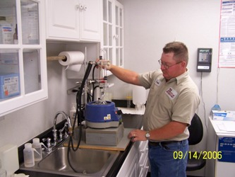 Man using wastewater treatment equipment